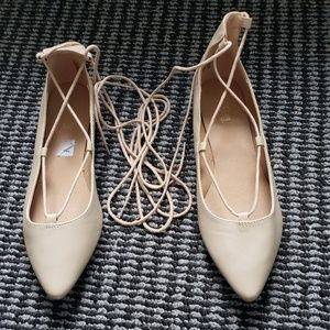 Pointed toe beige flats